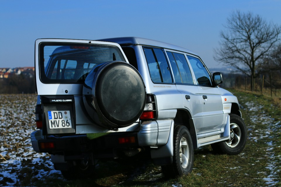 The Pajero on a field in Dresden from behind